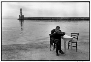 Photo © Constantine Manos/Magnum Photos Crete. Chania. 1962. Man reading newspaper.